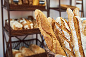 Bread baguettes in a basket in the baking shop
