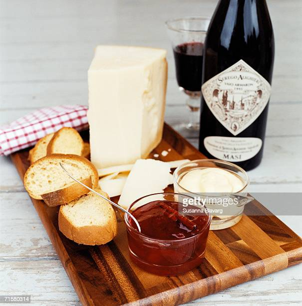 Bread cheese marmalade and wine.