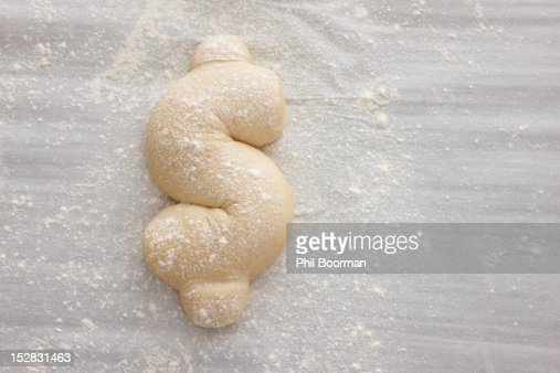 Bread dough shaped in dollar sign : Stock Photo