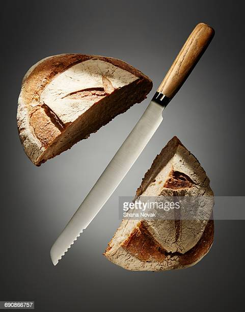 Bread Knife Slicing Through a Loaf