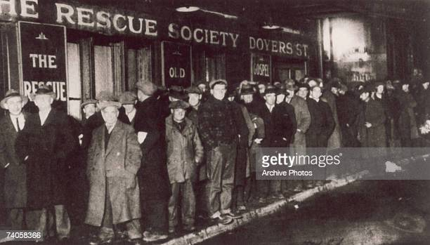 A bread line forms outside the Rescue Society in Doyers Street New York City during the Great Depression 1929