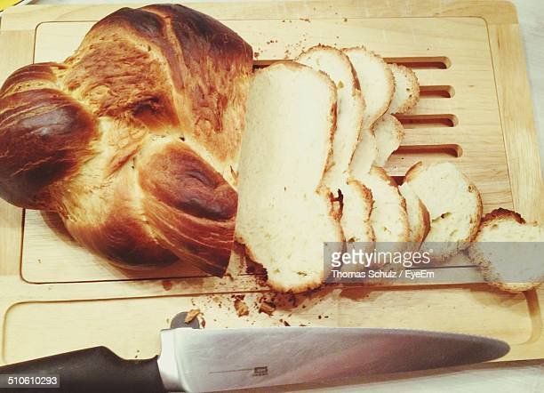 Bread loaf with slices on chopping board