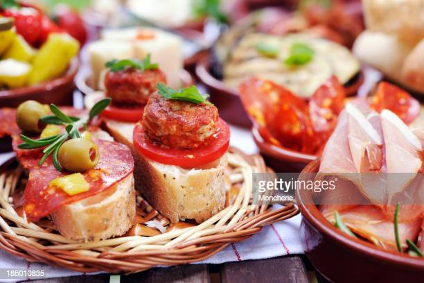 Bread, meat and cheese arranged on small plates
