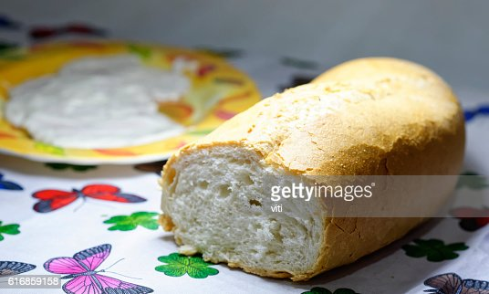 bread on top a table in my house : Stock Photo