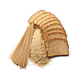 Whole grain bread slices, heap of brown rice and whole grain pasta carefully arranged on white backdrop. These are whole grain healthy eating food products specially indicated for dieting. The brown r