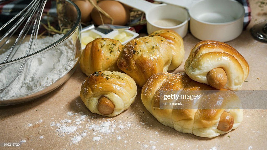 bread sausage roll on the wood table with ingredient. : Stock Photo