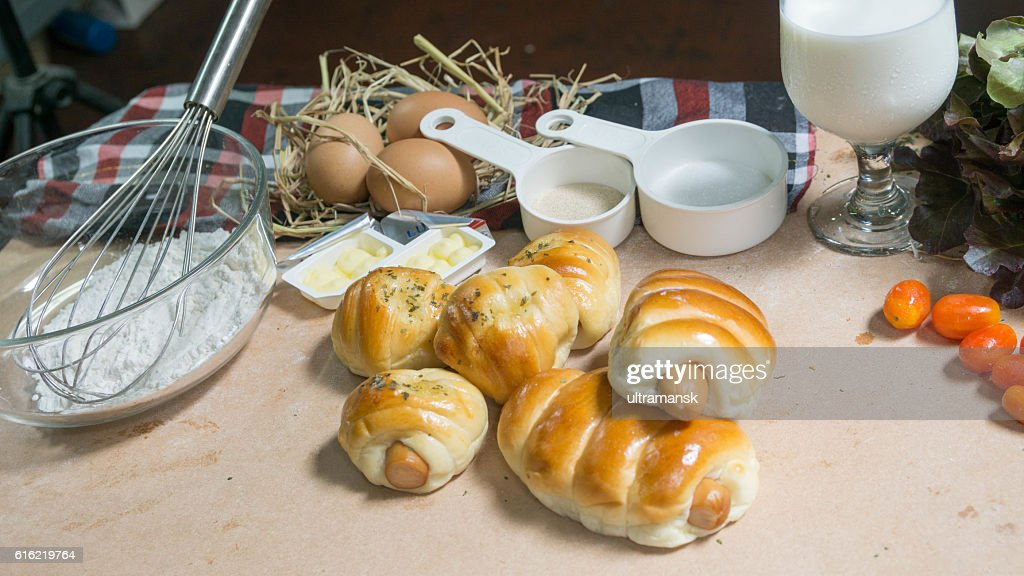 bread sausage roll on the wood table with ingredient. : Stock-Foto