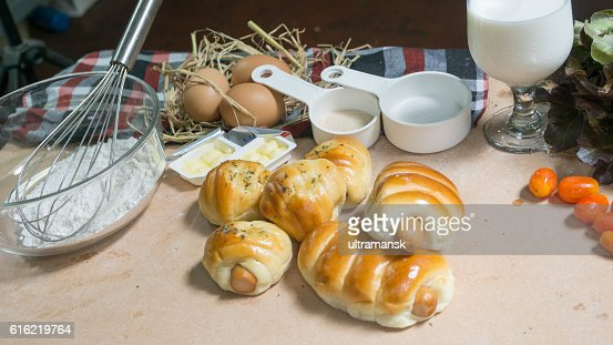bread sausage roll on the wood table with ingredient. : Stockfoto