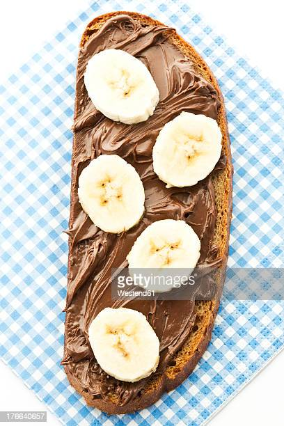 Bread topped with nutella and banana slices