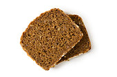 Bread whole grain two slices stacked over one another isolated on white background, top view, closeup