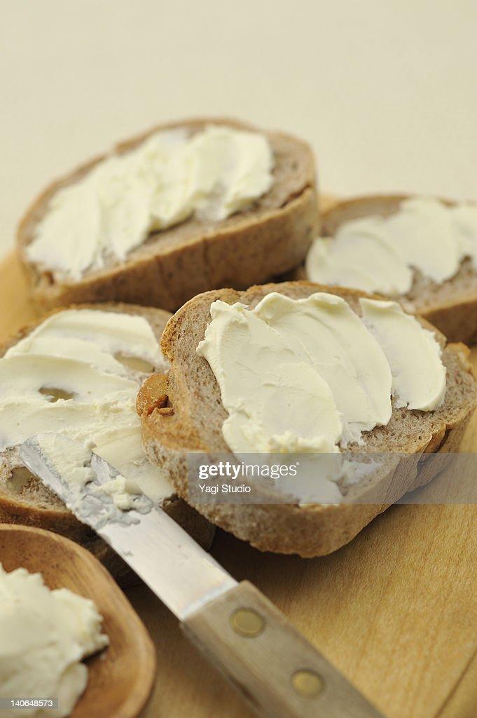 Bread with cream cheese : Stock Photo