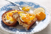 Morning toasts with butter and citrus marmalade