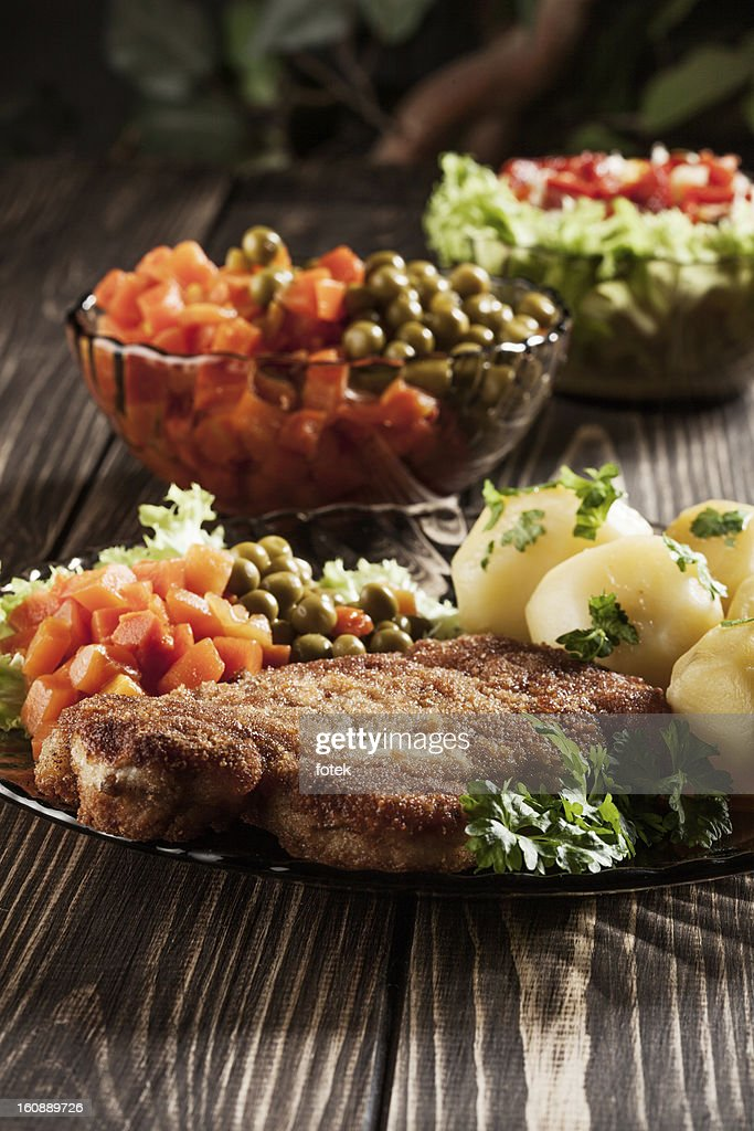 Breaded chop and potatoes. : Stock Photo