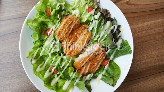 Breaded Fried Chicken With Organic Green Caesar Salad Tomato On