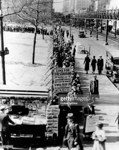 A breadline at the intersection of 6th Avenue and 42nd Street in New York City during the Depression that followed the Wall Street Crash