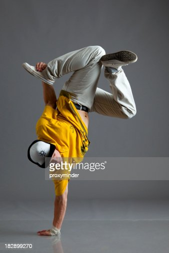 Break dancer stand on one arm