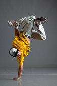 Break dancer stand on one arm