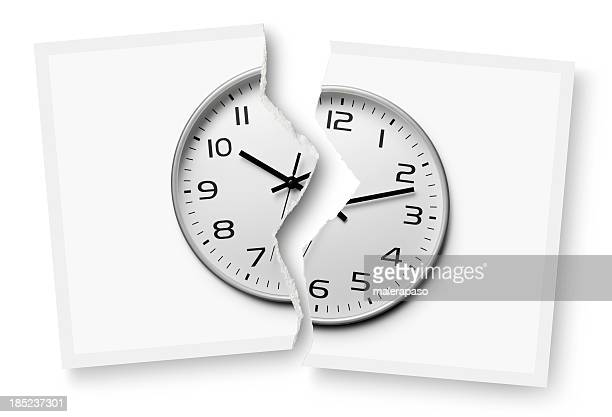 Break time. Torn photograph of a clock.