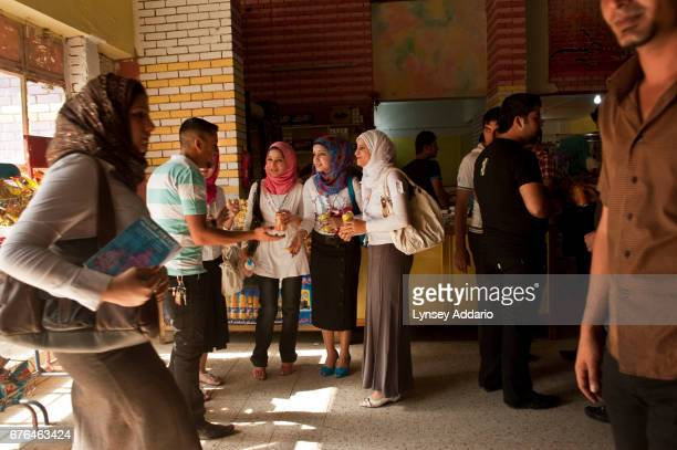 Break Time young women pass time in a cafe attached to the University of Baghdad passing blast walls plastered with political posters More than half...