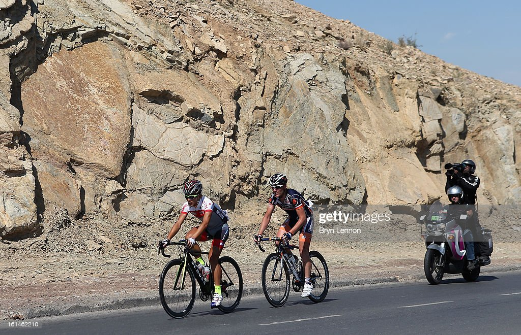 Breakaway riders Kohei Uchima of Japan and Bobbie Traksel of the Netherlands and Champion System in action during stage one of the 2013 Tour of Oman from Al Musannah to Sultan Qaboos University on February 11, 2013 in Muscat, Oman.