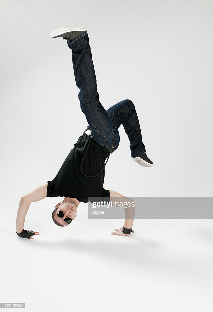 breakdancer performing handstand : Stock Photo