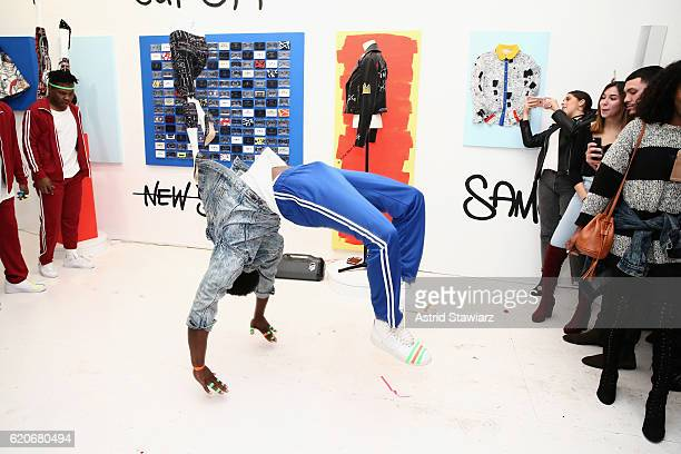 Breakdancers at the alice olivia x Basquiat CFDA Capsule Collection launch party on November 2 2016 in New York City