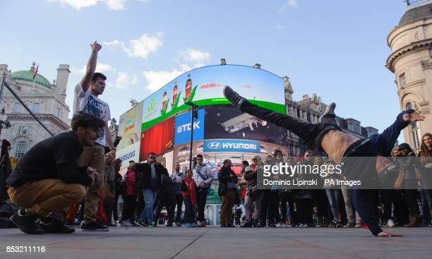 Breakdancers perform in Piccadilly Circus in central London