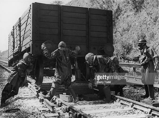 A breakdown squad on a training exercise to rerail a carriage under conditions of a poison gas attack on the Southern Railway Kent England 1st...