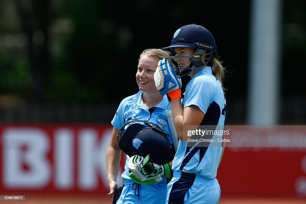 Breakers Alyssa Healy celebrates her century with teammate Ellyse Perry against Queensland Fire at Hurstville Oval in Sydney Australia Friday Oct...