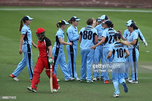 Breakers celebrate a wicket as Tegan McPharlin of SA Scorpions walks off during the WNCL Final match between the New South Wales and South Australia...