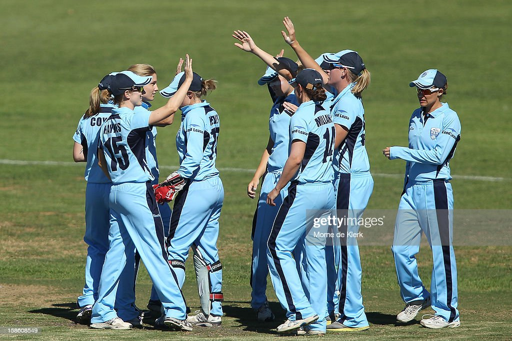 Breakers players celebrate after a wicket during the women's Twenty20 match between the South Australia Scorpions and the New South Wales Breakers at Prospect Oval on December 21, 2012 in Adelaide, Australia.