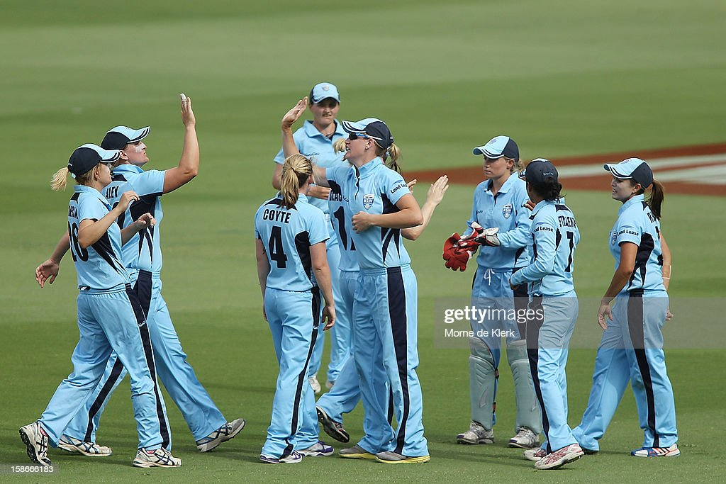Breakers players celebrate after getting a Scorpion wicket during the women's twenty20 match between the South Australia Scorpions and the New South Wales Breakers at Adelaide Oval on December 23, 2012 in Adelaide, Australia.