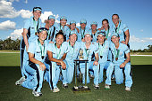 Breakers players pose with the trophy after winning the WNCL Final match between South Australia and New South Wales at Blacktown International...