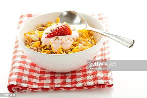 Breakfast bowl of cereals with yogurt and strawberry
