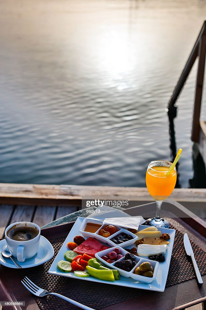 Breakfast by the sea with sunshine : Stock Photo