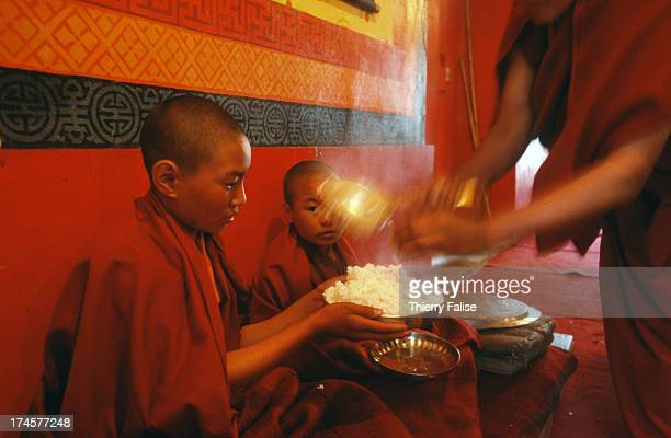Breakfast during an early morning prayer session at the Gangong monastery