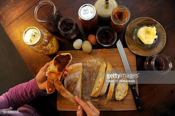 Breakfast includes freshly baked bread fresh eggs and from left to right yellow apple sauce concord grape juice Northern Spy apple sauce crabapple...
