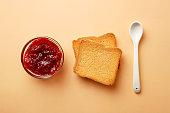 Breakfast ingredients. Jam and toast bread. Top view