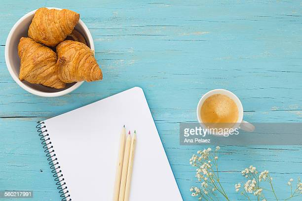 Breakfast, Notebook with coffee and croissants