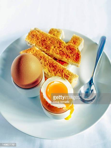 Breakfast of soft boiled eggs and toast