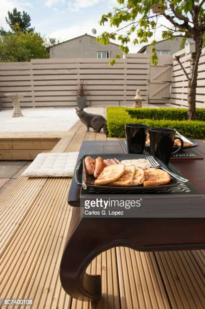Breakfast on a table on Zen style garden