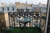 Coffee and croissant on the balcony of a French apartment in Montmartre
