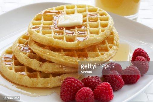 Breakfast plate of waffles and raspberries