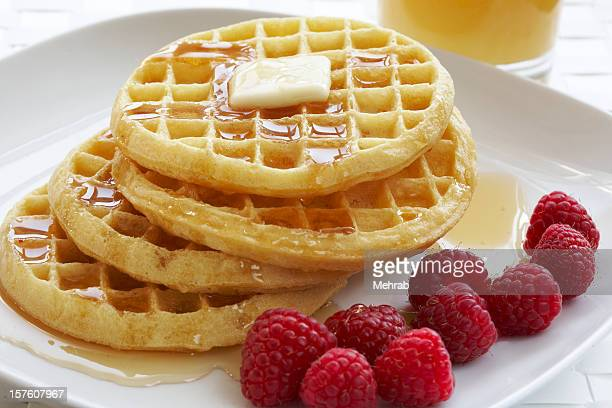 Breakfast plate of waffles and raspberries