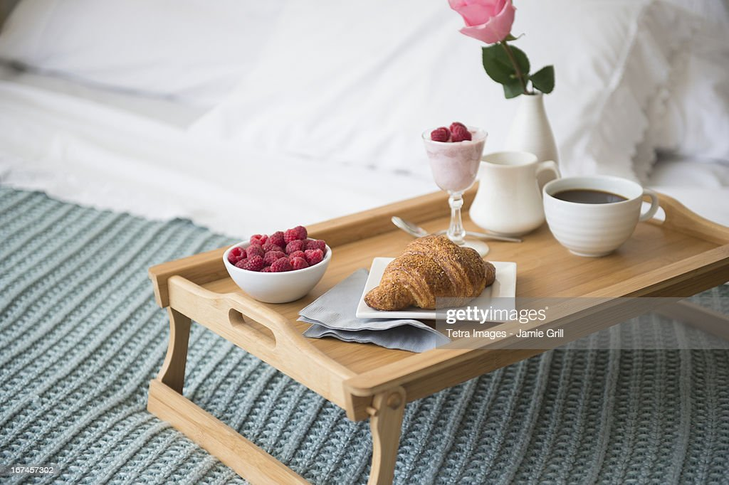 Breakfast plate on bed : Stock Photo