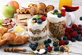 Breakfast served with coffee, orange juice, bread, parfaits and fruits. Balanced diet