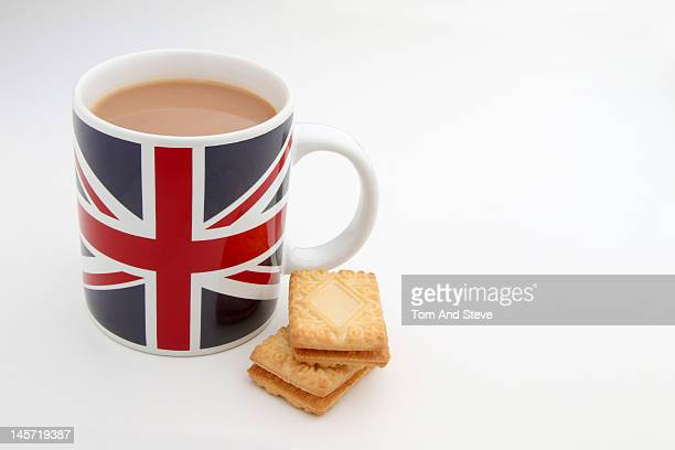 Breakfast tea in a Union Jack mug with biscuits