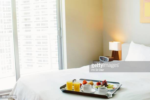 Breakfast tray on hotel bed