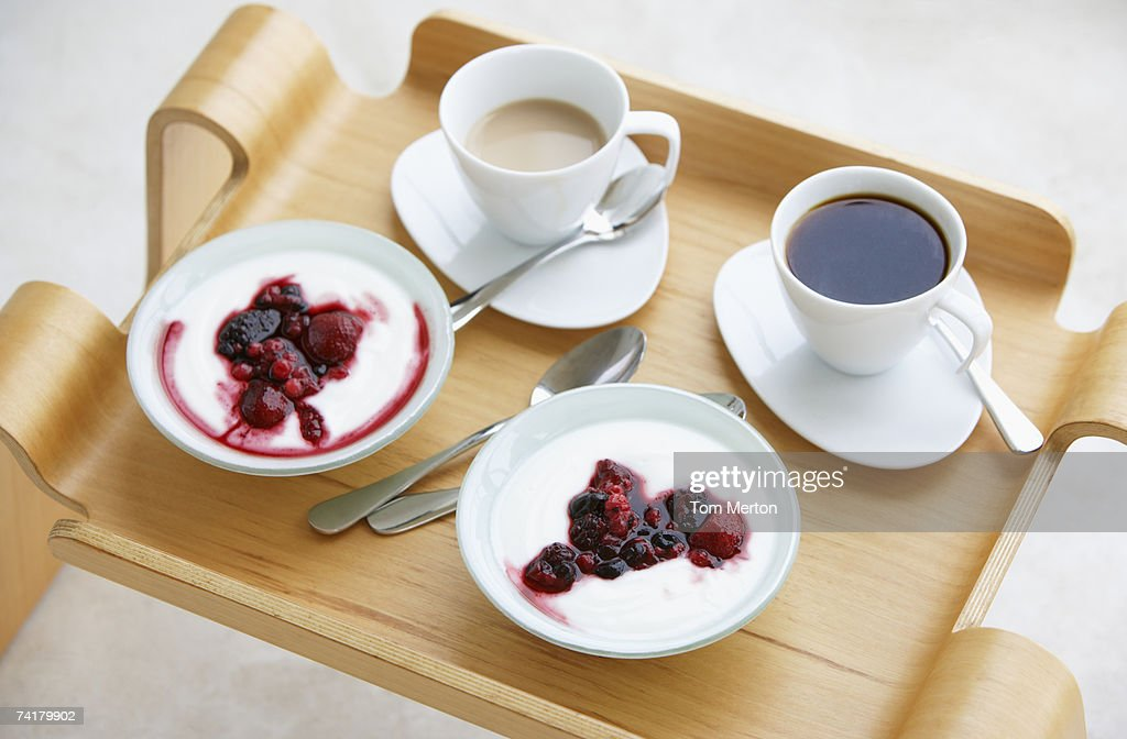 Breakfast tray with coffee and berries with cream : Stock Photo