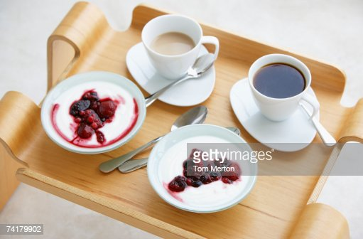 Breakfast tray with coffee and berries with cream : ストックフォト